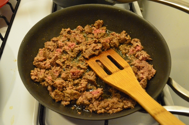 A few minutes after adding frozen beef to the pan, breaking up well.